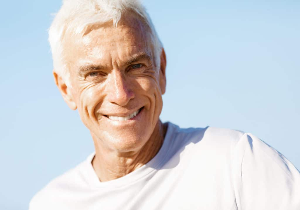 Portrait of healthy senior man smiling at camera